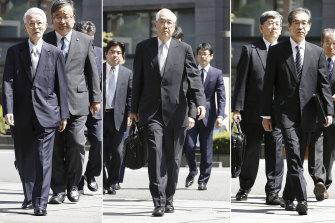 Former Tokyo Electric Power Co chairman Tsunehisa Katsumata and vice-presidents Sakae Muto and Ichiro Takekuro arrive at Tokyo District Court on Thursday.