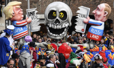 A carnival float depicts Donald Trump and Vladimir Putin cutting the INF (Intermediate-Range Nuclear Forces) Treaty during to the traditional carnival parade in Duesseldorf, Germany, last week. The US's new budget has allowances for increased nuclear capability.