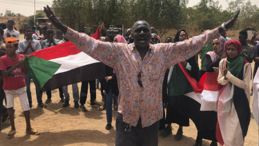 A Sudanese protester shouts slogans during a demonstration against the military council in Khartoum, Sudan.