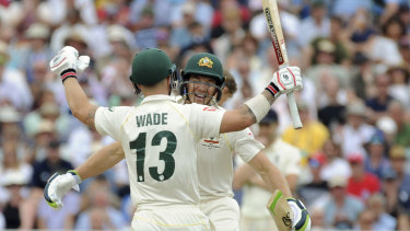 Matthew Wade celebrates his century with Tim Paine.