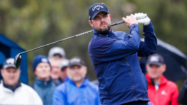 Cold, wet and wild: Marc Leishman competes for Australia in the World Cup of Golf.