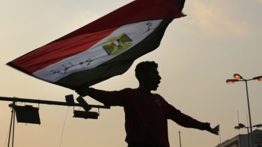 A protester waves the Egyptian flag during demonstrations in Cairo's Tahrir Square in late 2011.