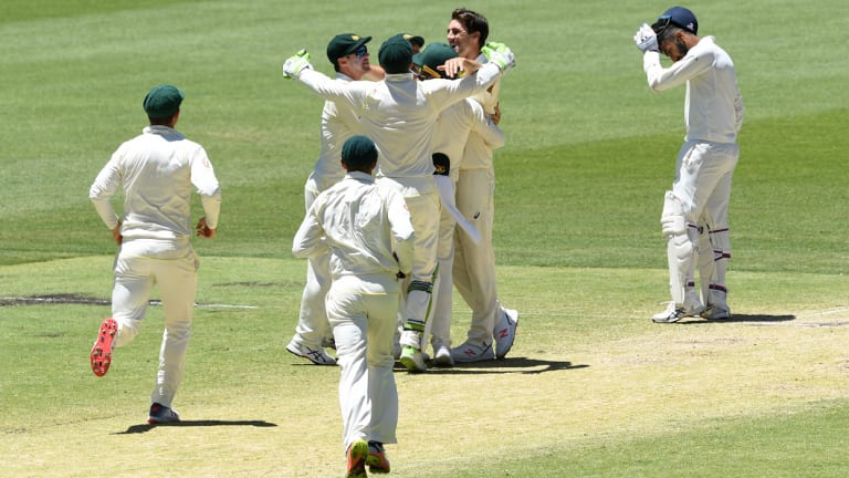Jubilant: Australia celebrate, but not too much, the final wicket of the match.