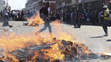 Opposition MDC party supporters protest in the streets of Harare during clashes with police.