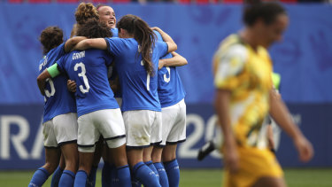 Italy celebrates winning their opening World Cup match against Australia.