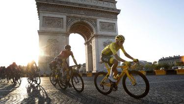 Stunning rise: Bernal passes the Arc de Triomphe.