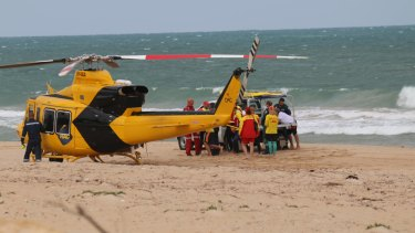 The man was airlifted from the beach.