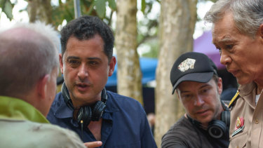 The Cave Director Tom Waller (middle left) and Australian director of photography Wade Muller (centre) brief actors on the set of The Cave.