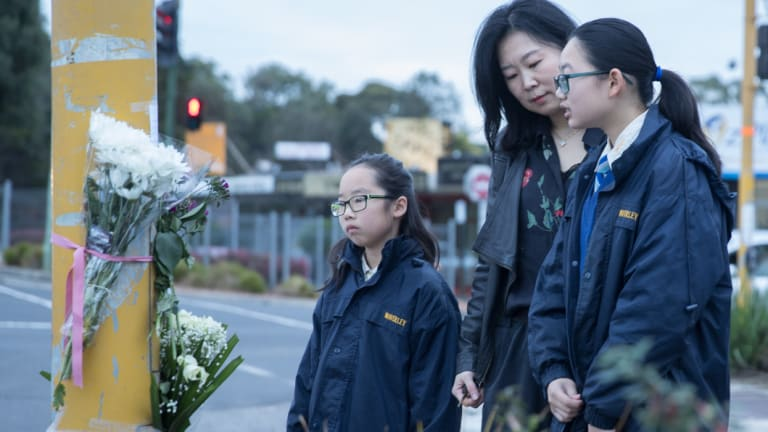 Cheryl Liu and daughters Grace and Debbie pay tribute to 14-year-old schoolgirl Aivy Nguyen.