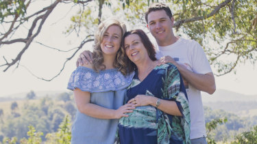 Surrogate Leonie McKinnon (centre) pregnant in 2017, with intended parents Rebecca MacDonald and Brodie Ashby.