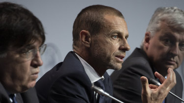 UEFA president Aleksander Ceferin, centre, says priority must go to finishing domestic leagues.