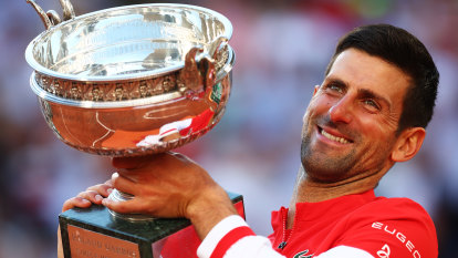 Djokovic comes from two sets down to beat Tsitsipas in French Open final