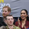 Prince Harry, Meghan shun reserved area to sit with crowd