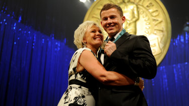 Mother's love: Leanne and Todd Carney after presentation of the 2010 Dally M medal.