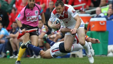 Brett Morris tries to make a break during the 2010 grand final when playing for the Dragons against the Roosters.