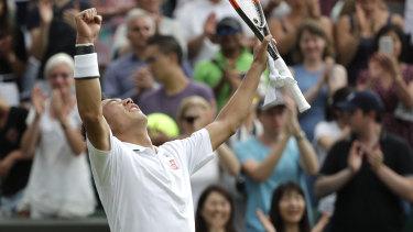 Kei Nishikori of Japan celebrates victory over Bernard Tomic.