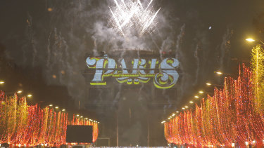 Fireworks illuminate the sky over the Arc de Triomphe.