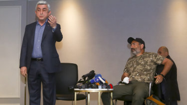Serzh Sargsyan, left, gestures as he leaves a meeting with protest leader Nikol Pashinian, right, in Yerevan on Sunday.