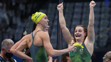 McKeon and Chelsea Hodges celebrate Australia's victory in the 4x100m medley relay.