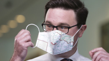 Deputy Nationals leader David Littleproud sporting a mask printed with the map of his Queensland electorate.