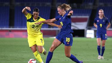 Matildas captain Sam Kerr is challenged by Sweden's Fridolina Rolfo.