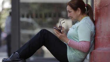 A women checks her mobile phone in Sao Paulo, Brazil.