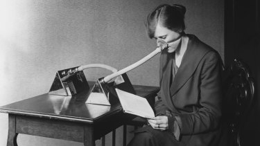 A woman reads while wearing a mask during the Spanish flu epidemic, which until recently had been puzzlingly absent from much literature.