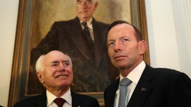 Former prime ministers John Howard and Tony Abbott.