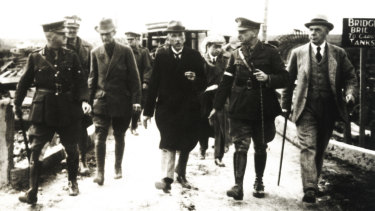 General John Monash conducts prime minister Billy Hughes and Lord Burham through newly occupied territory on the Western Front.