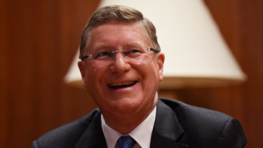 Denis Napthine has his portrait taken in Parliament House a week before the 2014 election, which Labor won.
