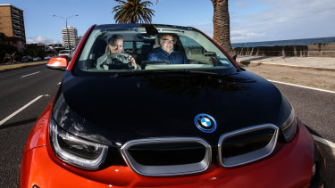 """I love my car,"" says electric vehicle owner Brigid Niall, pictured with husband Jock Main."