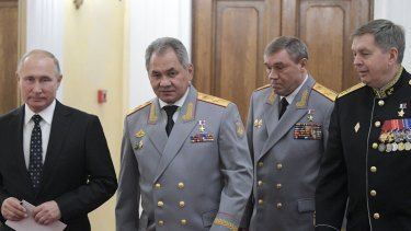 From the left: Russian President Vladimir Putin, Defence Minister Sergei Shoigu, First Deputy Defence Minister Valery Gerasimov, and Deputy GRU chief, Vice Admiral Igor Kostyukov, who Germany wants to sanction.