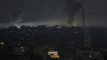 Smoke rises following an Israeli airstrike on Gaza City on Wednesday.