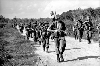 Australian troops make their way back to Bien Hoa Airbase after a joint operation with US forces.