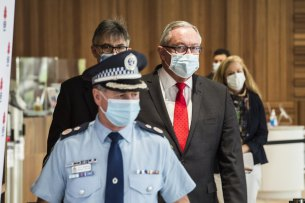 Health Minister Brad Hazzard, NSW Health's Dr Jeremy McAnulty and NSW Police Deputy Commissioner Michael Willing on Saturday.
