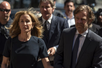 Felicity Huffman and her husband William H. Macy arrive at court for the sentencing.