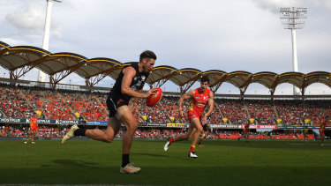 Still got the Blues: Carlton's Dale Thomas races up the wing at Metricon Stadium on the Gold Coast.