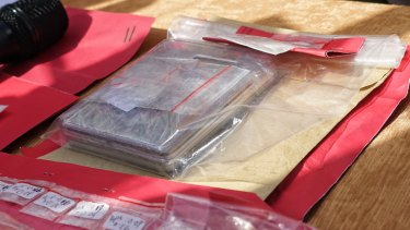 The scales and small plastic bags allegedly containing cocaine seized by Bali police.