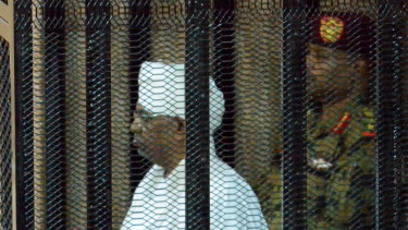 Sudan's ousted president Omar Hassan during his trial at a courtroom in Khartoum on Monday.