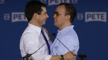 Pete Buttigieg, left, is joined by his husband Chasten Glezman after announcing he will seek the Democratic presidential nomination.