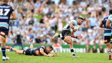 Off and running: Nikora makes a break against the Titans.