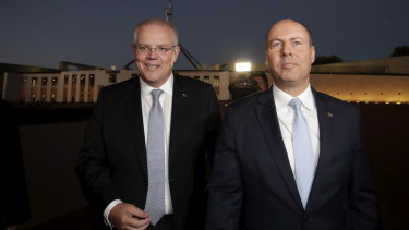 Prime Minister Scott Morrison and Treasurer Josh Frydenberg. The deficit shows the government is on track to record a razor thin surplus before the end of the financial year.