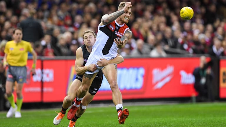 Tackling machine: Devon Smith chases down Tim Membrey.