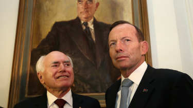 Former prime ministers John Howard and Tony Abbott.