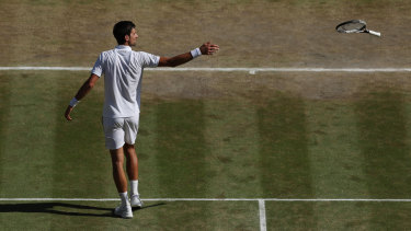 Throwing down: The moment Novac Djokovic secured yet another title at Wimbledon.