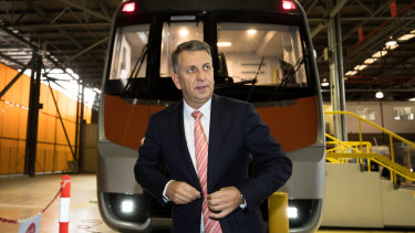 Transport Minister Andrew Constance in front of a mock of a new intercity train.
