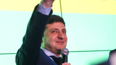 Ukrainian comedian Volodymyr Zelenskiy, flashes the victory sign at the end of the presidential elections.
