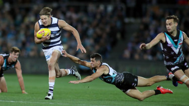Rhys Stanley of Geelong makes a clean break against Port Adelaide on Saturday night.