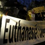 Protesters hold banners and placards as they demonstrate against a law authorising euthanasia for children, in Brussels last year.