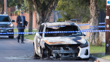 A burnt-out car at the scene of an overnight shooting in Bray Street, Reservoir.